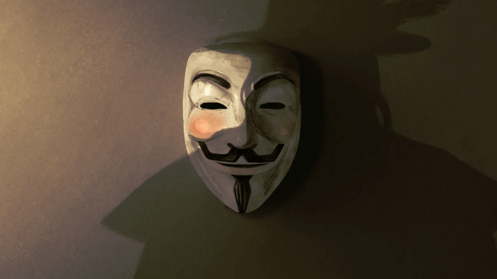 Guy Fawkes mask and a silhouette