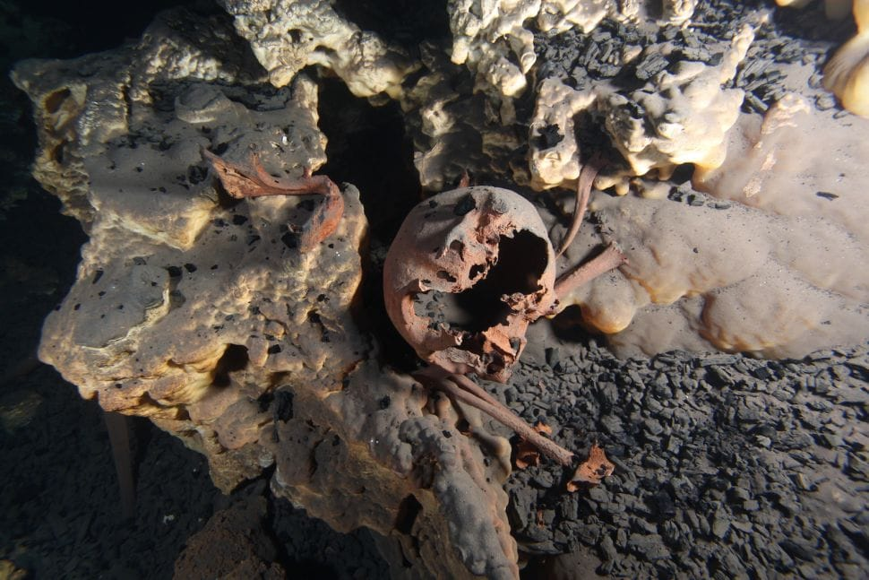 The original position of the skeletal remains inside the submerged cave of Muknal