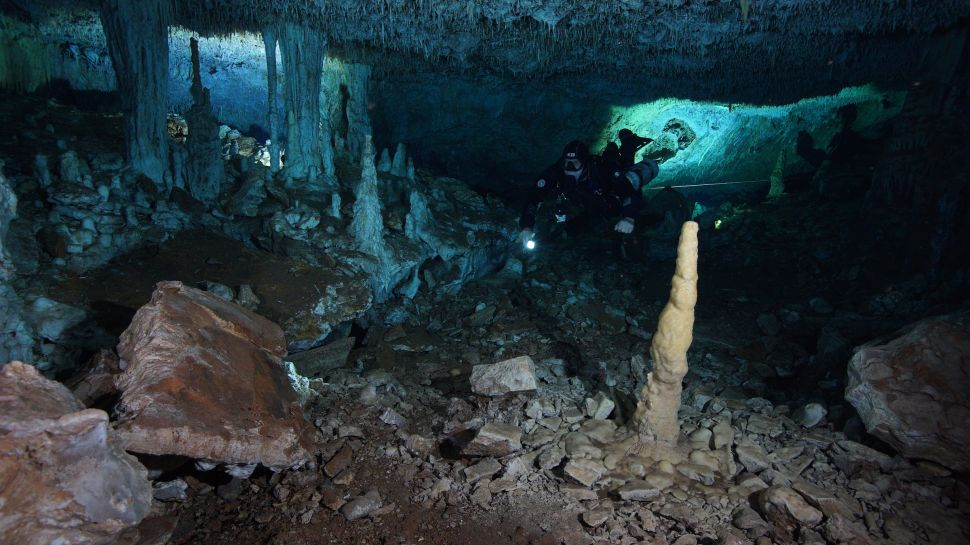 The underwater caves in the Mexican state of Quintina Roo pictured by a modern diver.