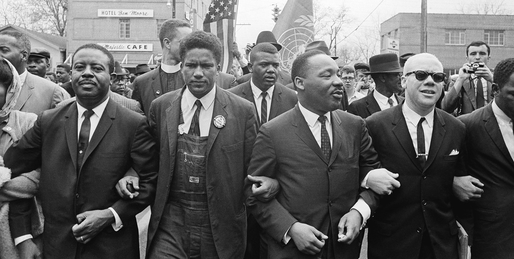 March 17, 1965. From left: Rev. Ralph Abernathy, James Foreman, King, Jesse Douglas, Sr., and John Lewis (partially out of frame).